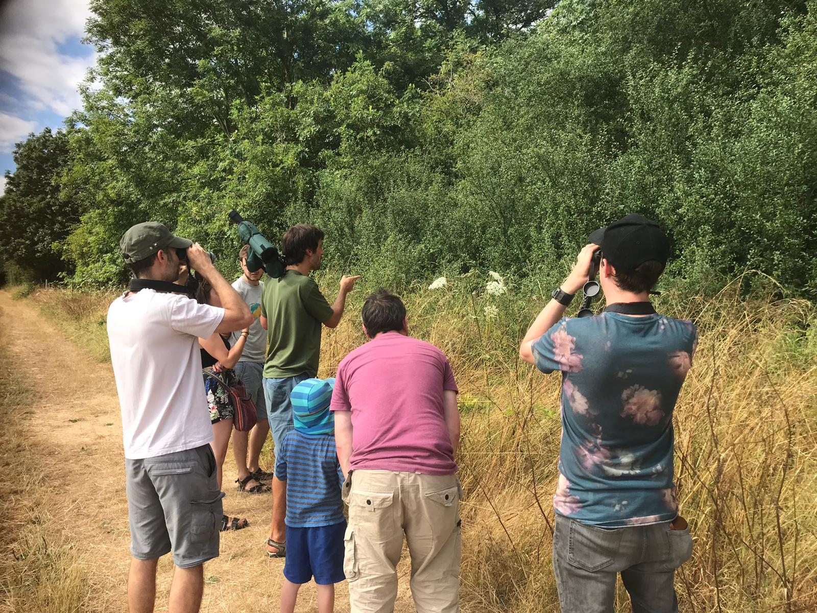 Nick Boyd leads a group of all ages in a nature walk around Hogacre Common Eco Park